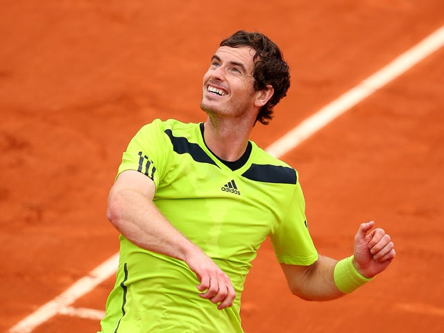 Andy Murray of Great Britain celebrates victory in his men's singles match against Marinko Matosevic of Australia on day five of the French Open at Roland Garros on May 29, 2014