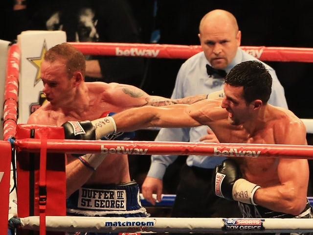 Carl Froch knocks out George Groves during the IBF & WBA World Super Middleweight Title Fight at Wembley Stadium on May 31, 2014