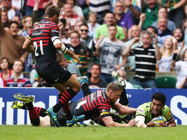 Chris Ashton of Saracens fails to stop George Pisi of Northampton Saints scoring their second try during the Aviva Premiership Final at Twickenham on May 31, 2014