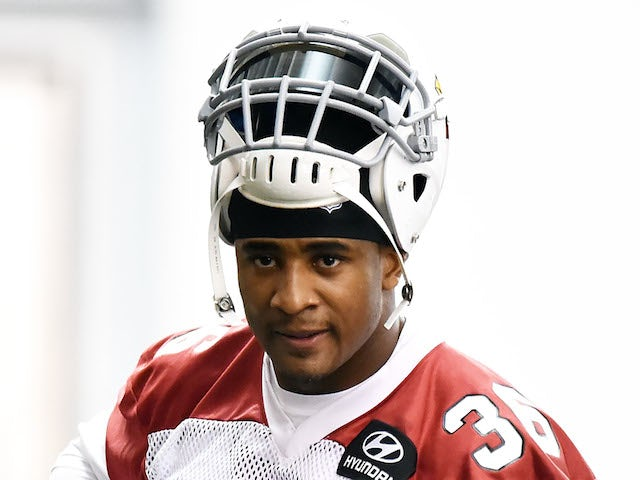 Deone Bucannon #36 of the Arizona Cardinals adjusts his shoulder pads during a Rookie Minicamp practice on May 23, 2014