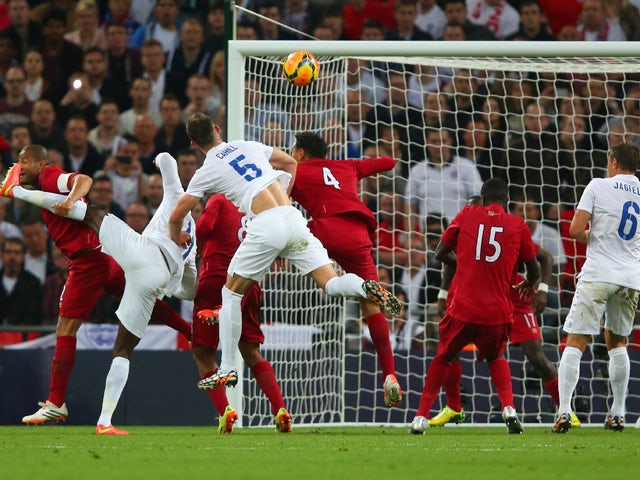 Gary Cahill of England heads in their second goal during the international friendly match between England and Peru at Wembley Stadium on May 30, 2014