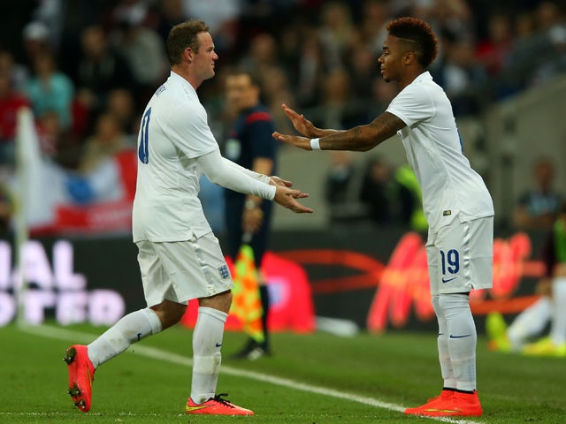 Raheem Sterling of England replaces Wayne Rooney of England during the international friendly match between England and Peru at Wembley Stadium on May 30, 2014