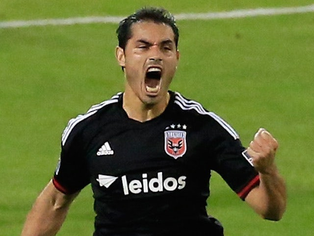Fabian Espindola #9 of D.C. United celebrates after scoring a goal against the Houston Dynamo during the second half at RFK Stadium on May 21, 2014
