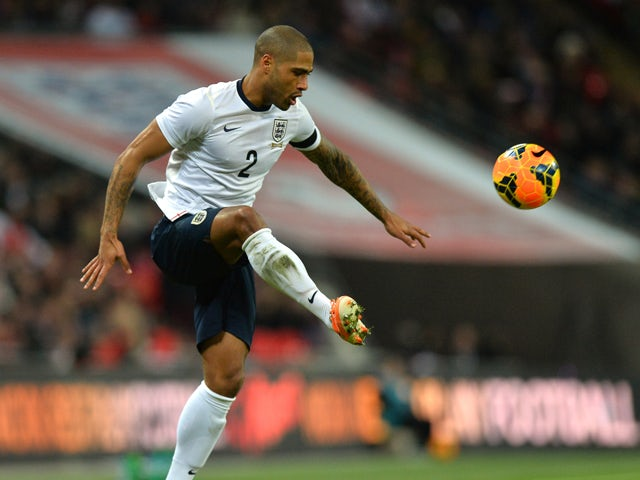 England defender Glen Johnson controls the ball during the international friendly football match between England and Denmark at Wembley Stadium in London on March 5, 2014