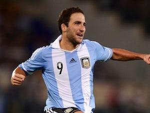 Argentina striker Gonzalo Higuain celebrates scoring for Argentina on August 14, 2013.