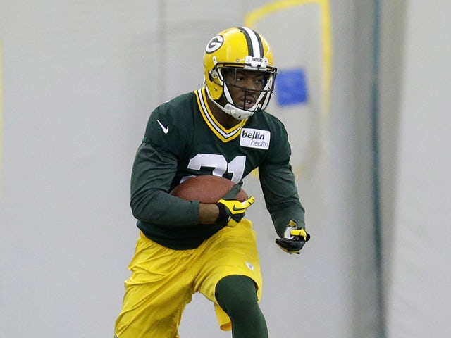 Ha Ha Clinton-Dix #21 of the Green Bay Packers runs through drills during rookie mini camp at Don Hudson Center on May 16, 2014