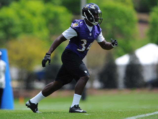 Running back Lorenzo Taliaferro #34 of the Baltimore Ravens participates in the Baltimore Ravens Rookie Minicamp on May 17, 2014