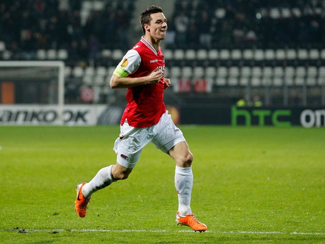 Nick Viergever #4 of AZ is celebrates after he scores his teams first goal of the game during the UEFA Europa League Round of 32 match between AZ Alkmaar and FC Slovan Liberec at the AZ Stadium on February 27, 2014