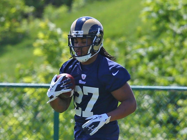 Tre Mason #27 of the St. Louis Rams participates in a rookie minicamp at Rams Park on May 16, 2014