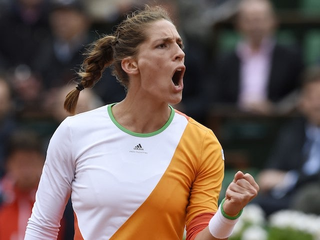 Germany's Andrea Petkovic celebrates after winning a point during her French Open quarter-final against Italy's Sara Errani at the Roland Garros in Paris on June 4, 2014