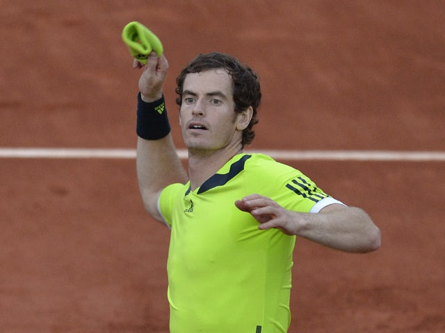 Great Britain's Andy Murray celebrates his victory over France's Gael Monfils at the end of their French tennis Open quarter final match at the Roland Garros stadium in Paris on June 4, 2014