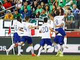Bruno Alves #2 of Portugal celebrates his goal with teammates in the final seconds of extra time in the second half against Mexico on June 7, 2014