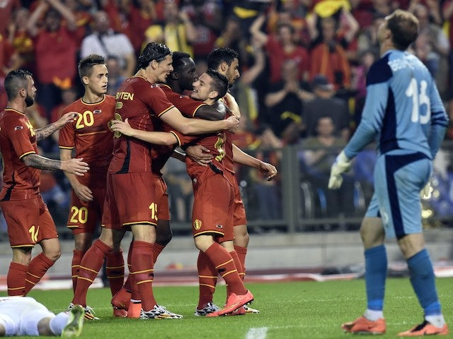Belgium's forward Dries Mertens (R) celebrates after scoring during during the FIFA 2014 World Cup friendly football match Belgium vs Tunisia at the King Baudouin Stadium, on June 7, 2014