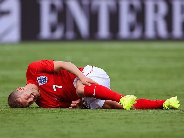 Jack Wilshere of England lies injured during the International friendly match between England and Ecuador at Sun Life Stadium on June 4, 2014