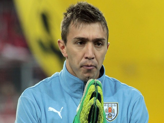 Uruguay's Fernando Muslera poses before the International friendly football friendly football match Austria vs Uruguay ahead of the FIFA World Cup 2014 on March 5, 2014