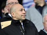 South African Chief Executive Ivan Gazidis looks on before the English Premier League football match between Queens Park Rangers and Arsenal at Loftus Road in London on May 4, 2013
