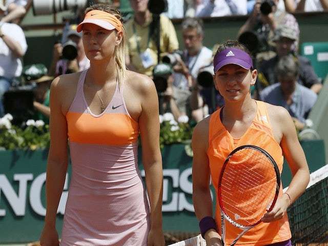 Russia's Maria Sharapova (L) and Romania's Simona Halep pose before the start of their French tennis Open final match at the Roland Garros stadium in Paris on June 7, 2014