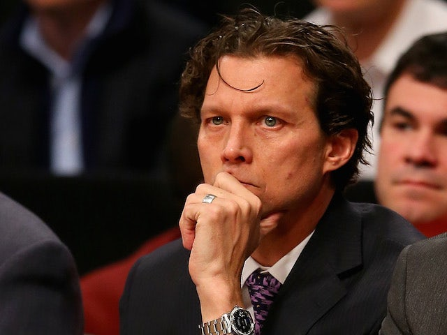 Assistant coach Quin Snyder and head coach Mike Budenholzer of the Atlanta Hawks look on in the second half against the Brooklyn Nets at the Barclays Center on January 6, 2014