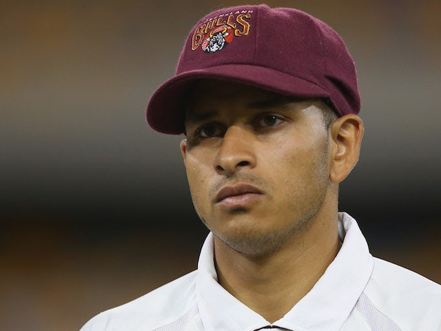 Usman Khawaja of the Bulls looks on during day two of the Sheffield Shield match between Queensland and Western Australia at The Gabba on March 4, 2014