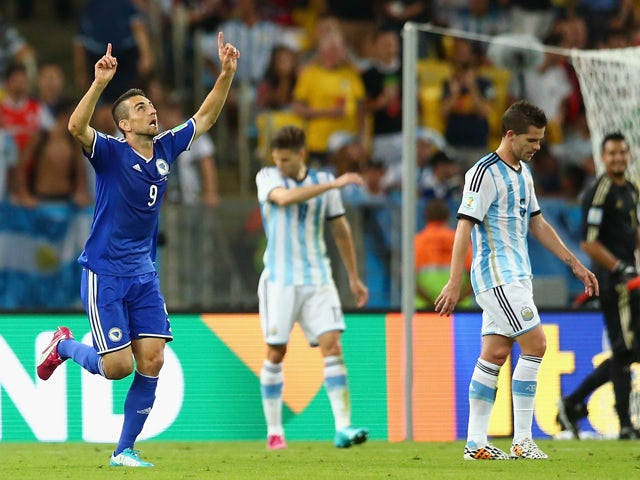 Vedad Ibisevic Bosnia and Herzegovina celebrates scoring his team's first goal during the 2014 FIFA World Cup Brazil Group F match between Argentina and Bosnia-Herzegovina at Maracana on June 15, 2014