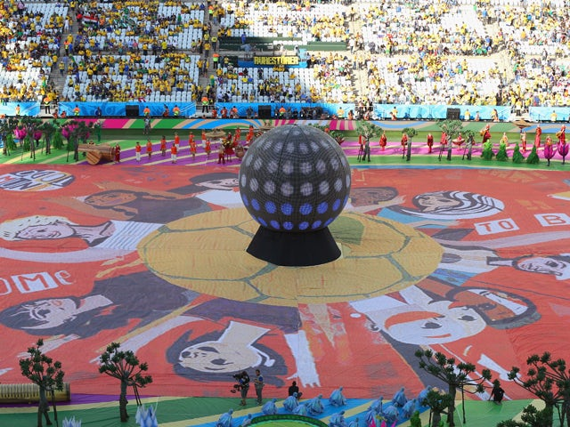 The Happiness Flag is seen as artists perform during the Opening Ceremony of the 2014 FIFA World Cup Brazil prior to the Group A match between Brazil and Croatia at Arena de Sao Paulo on June 12, 2014