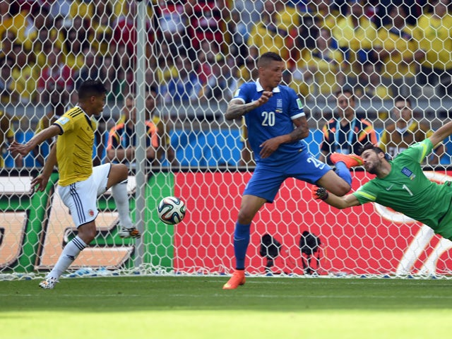 Colombia's forward Teofilo Gutierrez scores his team's second goal during a group C football match between Colombia and Greece at the Mineirao Arena in Belo Horizonte during the 2014 FIFA World Cup on June 14, 2014