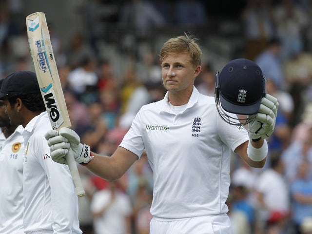Englands Joe Root acknowledges the crowd after finishing the innings on 200 runs not out during the second days play in the first cricket Test match between England and Sri Lanka at Lord's cricket ground in London on June 13, 2014