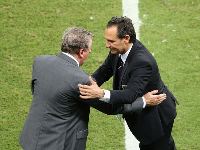 England manager Roy Hodgson and head coach Cesare Prandelli of Italy shake hands after the 2014 FIFA World Cup Brazil Group D match between England and Italy at Arena Amazonia on June 14, 2014