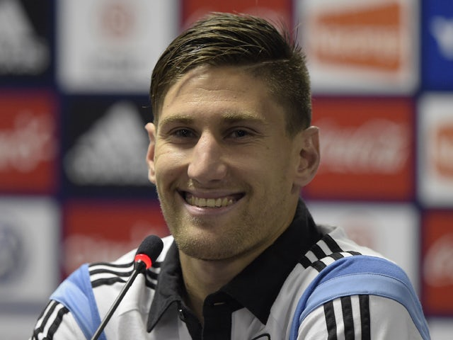 Argentina's defender Federico Fernandez addresses a press conference after a training session at 'Cidade do Galo', their base camp in Vespasiano, near Belo Horizonte, some 470 Km north of Rio de Janeiro, Brazil on June 13, 2014
