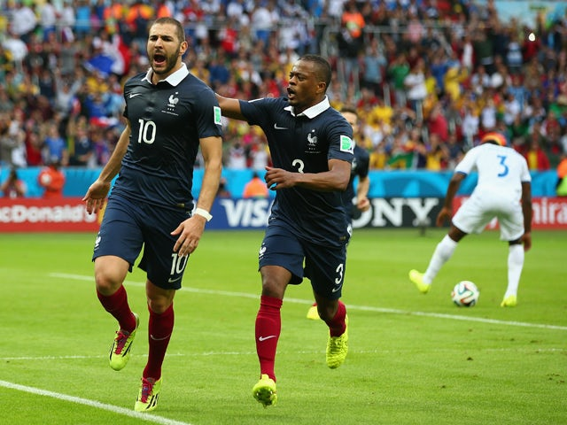 Karim Benzema of France celebrates scoring his team's first goal on a penalty kick with Patrice Evra during the 2014 FIFA World Cup Brazil Group E match between France and Honduras at Estadio Beira-Rio on June 15, 2014