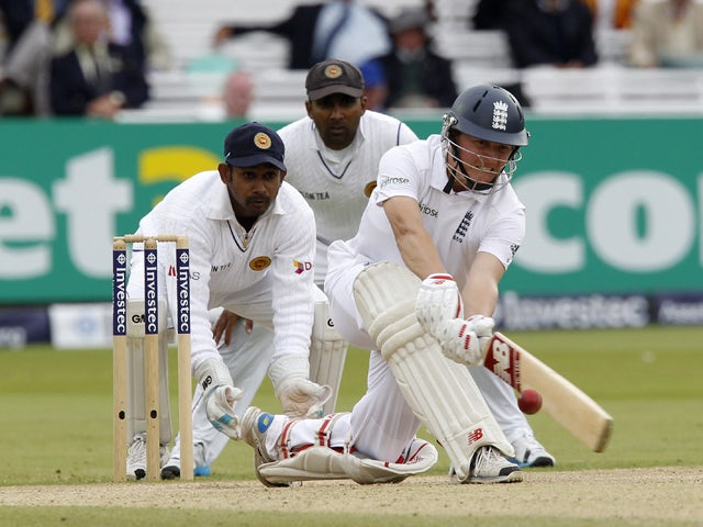 Englands Gary Ballance plays a sweep shot watched by Sri Lankas wicketkeeper Prasanna Jayawardene (L) and Sri Lankas Mahela Jayawardene (C) during play on the fourth day of the first cricket Test match between England and Sri Lanka at Lord's cricket groun
