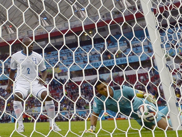 Honduras' goalkeeper and captain Noel Valladares handles the ball to score an own goal from a shot by France's Karim Benzema during a Group E football match between France and Honduras at the Beira-Rio Stadium in Porto Alegre during the 2014 FIFA World Cu