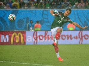 Mexico's forward Javier Hernandez kicks the ball during the Group A football match between Mexico and Cameroon at the Dunas Arena in Natal during the 2014 FIFA World Cup on June 13, 2014