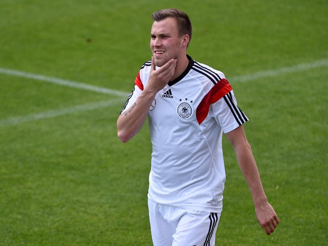 Germany's defender Kevin Grosskreutz reacts during a training game of the German national football team and the under 20 German national team at the training ground in San Martino in Passiria, Italy, on May 25, 2014