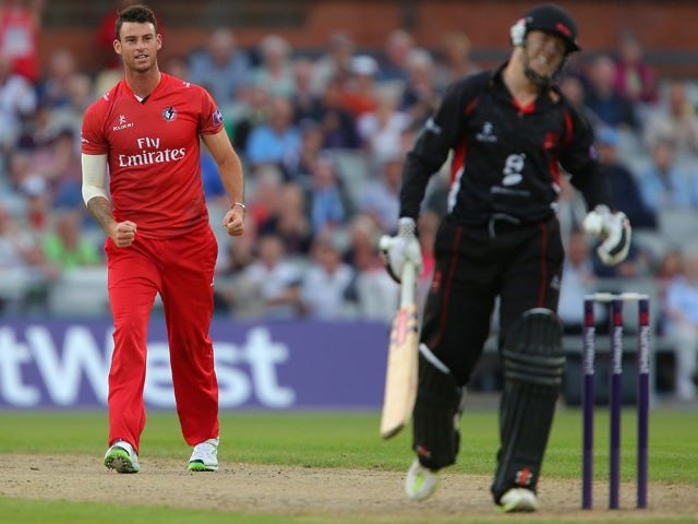Jordan Clark of Lancashire Lightning celebrates taking the wicket of Niall O'Brien of Leicestershire Foxes during the Lancashire Lightning v Leicestershire - Natwest T20 Blast at Old Trafford on June 13, 2014