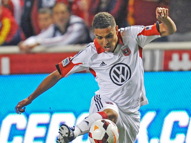 Luis Silva #12 of D.C. United kicks the ball against Real Salt Lake during the 2013 U.S. Open Cup Final at Rio Tinto Stadium October 1, 2013