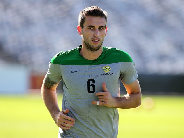 Matthew Spiranovic runs during an Australian Socceroos training session at Central Coast Stadium on May 21, 2014