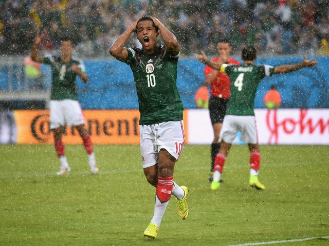 Giovani dos Santos of Mexico reacts after his goal was disallowed due to an offsides call in the first half during the 2014 FIFA World Cup Brazil Group A match between Mexico and Cameroon at Estadio das Dunas on June 13, 2014