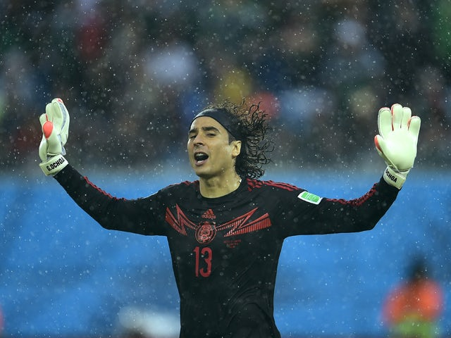Mexico's goalkeeper Guillermo Ochoa gestures during a Group A football match between Mexico and Cameroon at the Dunas Arena in Natal during the 2014 FIFA World Cup on June 13, 2014
