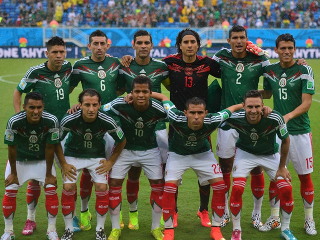Mexico's national football team players pose for a picture before the Group A football match between Mexico and Cameroon at the Dunas Arena in Natal during the 2014 FIFA World Cup on June 13, 2014