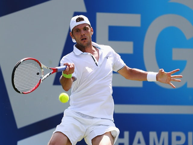 Paul-Henri Mathieu of France plays a forehand shot against Aljaz Bedene of Slovenia during their first round match on day one of the Aegon Championships at Queens Club on June 9, 2014