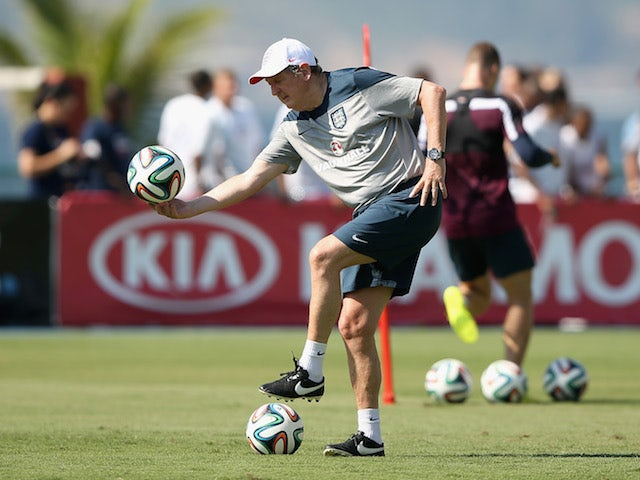 England manager Roy Hodgson bends down during a training session in Rio de Janeiro on June 9, 2014