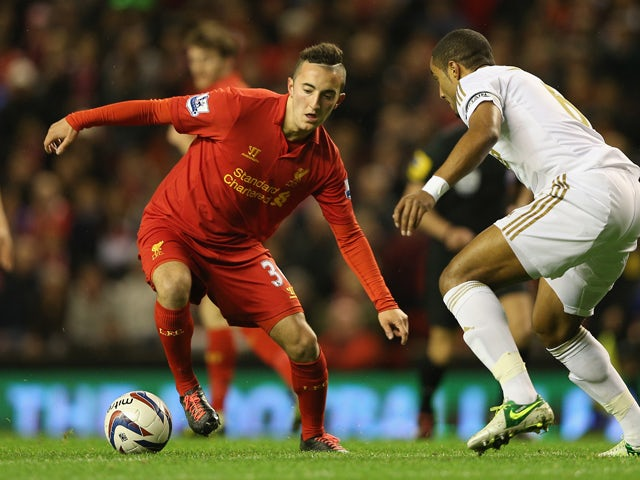 Samed Yesil of Liverpool competes with Ashley Williams of Swansea City during the Capital One Cup Fourth Round match between Liverpool and Swansea City at Anfield on October 31, 2012