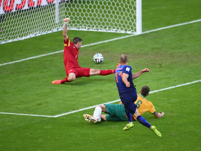 Netherlands winger Arjen Robben scores the first goal of the World Cup Group B match against Australia in Porto Alegre on June 18, 2014