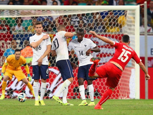 Blerim Dzemaili of Switzerland shoots and scores his team's first goal against France on June 20, 2014