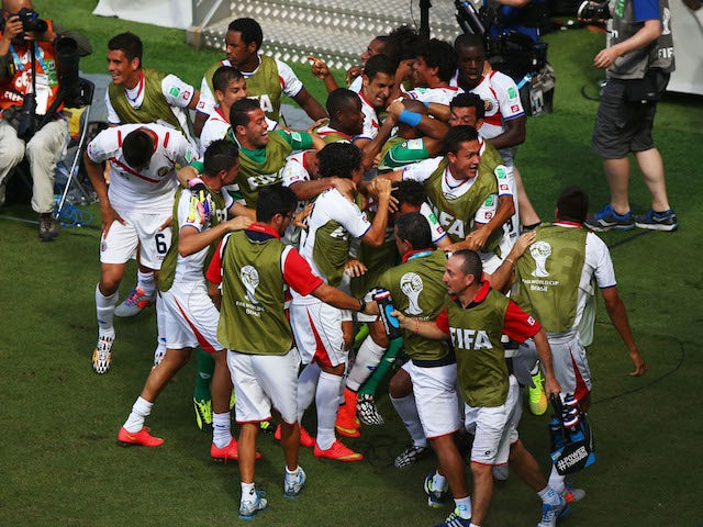 Costa Rica players celebrate after Bryan Ruiz scored their team's first goal during the 2014 FIFA World Cup Brazil Group D match against Italy on June, 20, 2014
