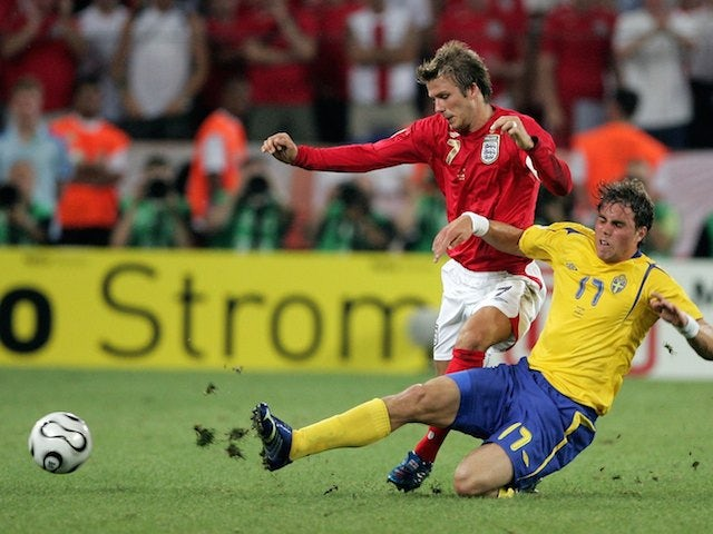 David Beckham of England is tackled by Johan Elmander of Sweden during the FIFA World Cup Germany 2006 Group B match between Sweden and England  on June 20, 2006