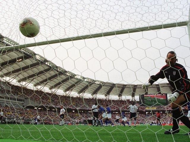 Brazil's Ronaldinho lobs England goalkeeper David Seaman on June 21, 2002.