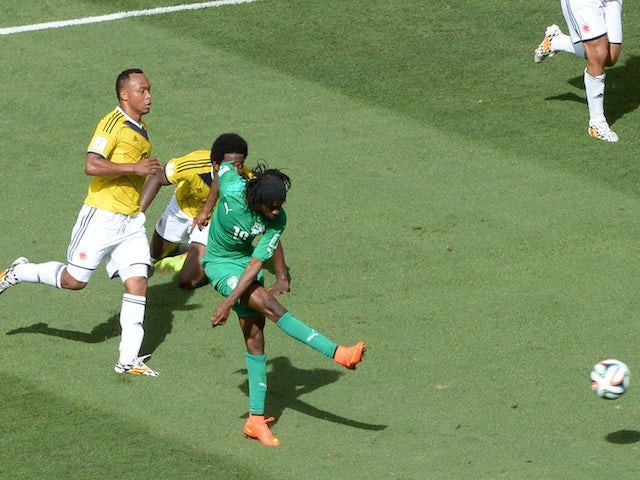 Ivory Coast's forward Gervinho (C) kicks the ball to score during the Group C football match between Colombia and Ivory Coast on June 19, 2014