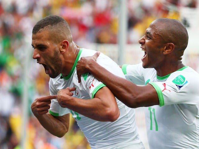 Islam Slimani of Algeria (L) celebrates scoring his team's first goal during the 2014 FIFA World Cup Brazil Group H match against South Korea on June 22, 2014